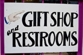 gift shop and restrooms bathroom sign