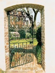 A gate and garden in Charleston, SC