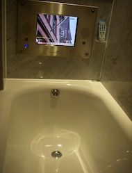 hotel TV television bathtub