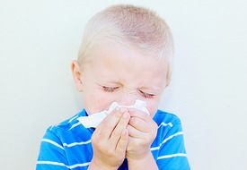blowing nose tissue sick boy child