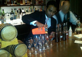 Bartender pouring barrel aged spirits at Two E Bar at The Pierre