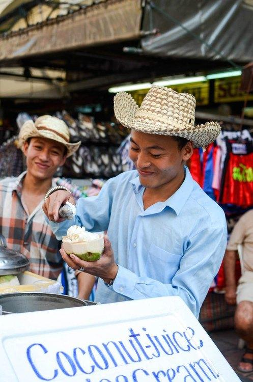 Vendors on Khao San Road selling coconut ice cream from a cart