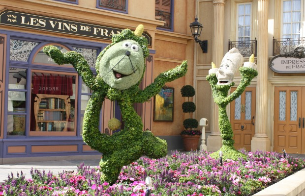 Cogsworth and Lumiere topiaries at Epcot
