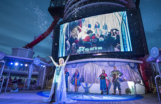 "On select Disney Magic and Disney Wonder sailings, families enjoy ""Freezing the Night Away with Anna, Elsa and Friends,"" a family-friendly interactive deck party featuring the famous royal sisters of Arendelle and their fun-loving Nordic companions. The celebration culminates with a ""Let it Go"" sing-along, complete with a touch of magic courtesy of everyone's favorite ice queen, Elsa. (Kent Phillips, photographer)"