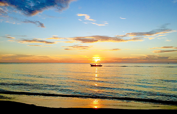 Fishing boat returning to Big Corn Island, Nicaragua, at sunset/Mark Orwoll