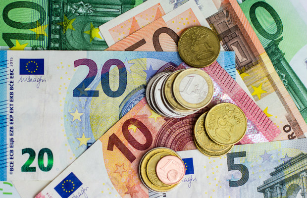 Euro coins and dollars/iStock